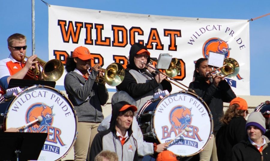The Baker University Band playing to hype the crowd and players. The band played during each stoppage of play against Evangel University.