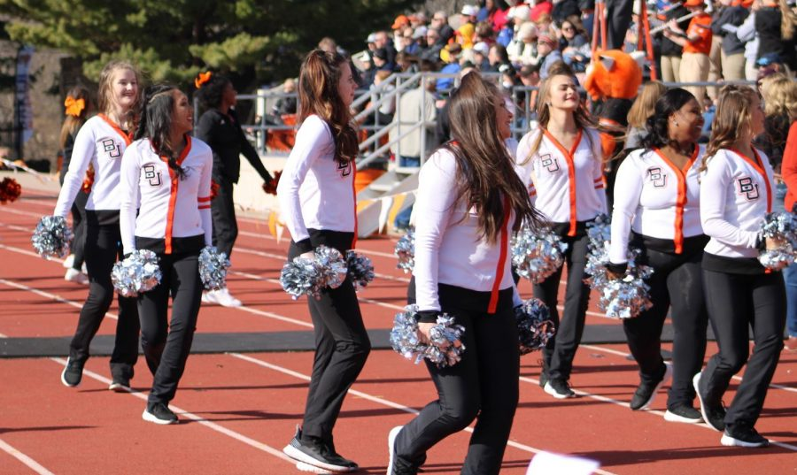 The Baker University Cheer team cheers during timeouts and between plays. The Wildcats defeat no. 17 Evangel University 28-21.