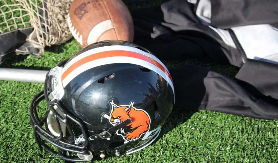 The Baker University Football team's helmet and ball sitting on the field of Liston Stadium on Nov. 9. The Baker Football team is now at 4-0 on the Heart of America South Division.