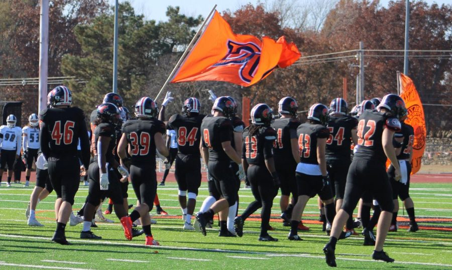 The Wildcat football team rushing onto the field. The football game on Nov. 16 had a crew from ESPN  to film and livestream the Baker University v.s. Evangel University game.