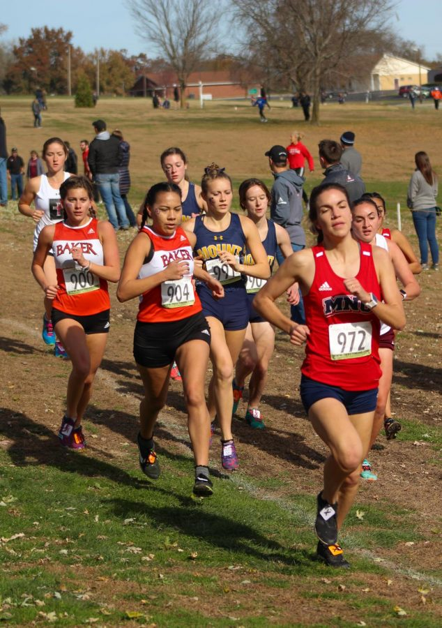 From the left, Junior Emily Chambers and Senior Janeane Hernandez finished seventh and 12th overall.