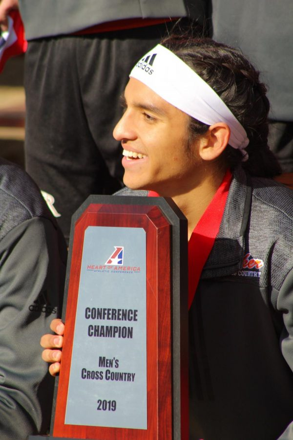Senior Greg Flores smiles wide as he enjoys his first team conference win. Flores has attended the NAIA national cross country all four years of his collegiate career.
