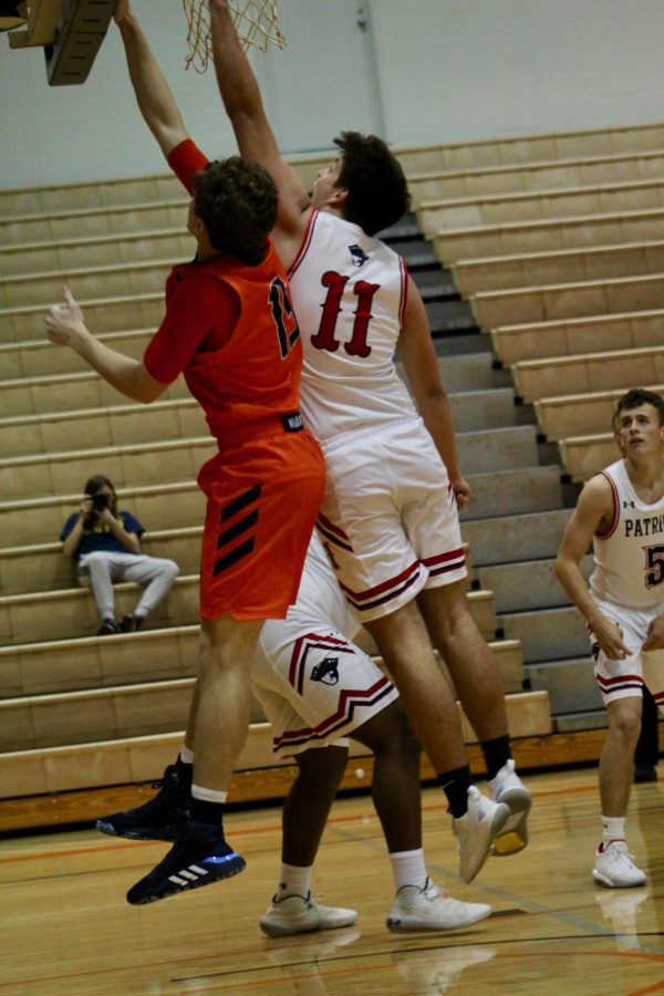 Sophomore Mason Dukes going up for a basket against Baptist Bible College. The Wildcats won 80-74 securing its first win of the season.