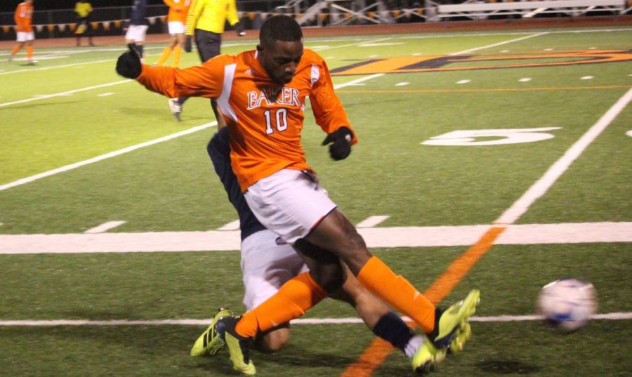 Senior Steeve Pouna passing the ball forward while being challenged by a Graceland midfielder. Pouna finishes his final regular season with four goals and eight shots on target.