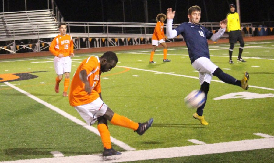 Sophomore Mohamet Cisse attempts to clear the ball forward for a Wildcat player to use. The Wildcats faced off against Graceland University on Oct. 31 in Liston Stadium.