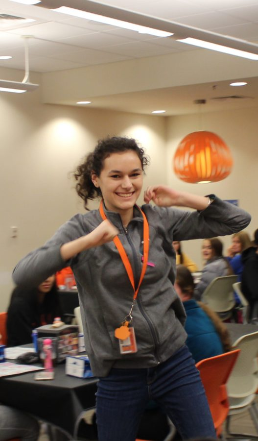 Freshman Maria Gutierrez celebrates her win at the Student Activities Council hosted grocery bingo. Gutierrez won in a rock, paper, scissors match with another student to claim groceries.