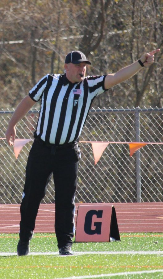 The referee calling a penalty on the Liston Stadium football field. Benedictine College scored only one touchdown early in the fourth quarter.