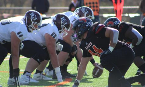 Junior Jon Scire lines up on defense to stop the Evangel offense on second down. On the season Scire totals 34 tackles including tackles for 40.5 yards for loss.