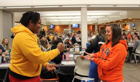 (Left) Freshmen Brandon Ammons and Brooklynn Lamberd play rock, paper, scissors to see who wins the round in grocery bingo. Student Activities Council holds grocery bingo Nov. 5 in the Harter Student Long Center.