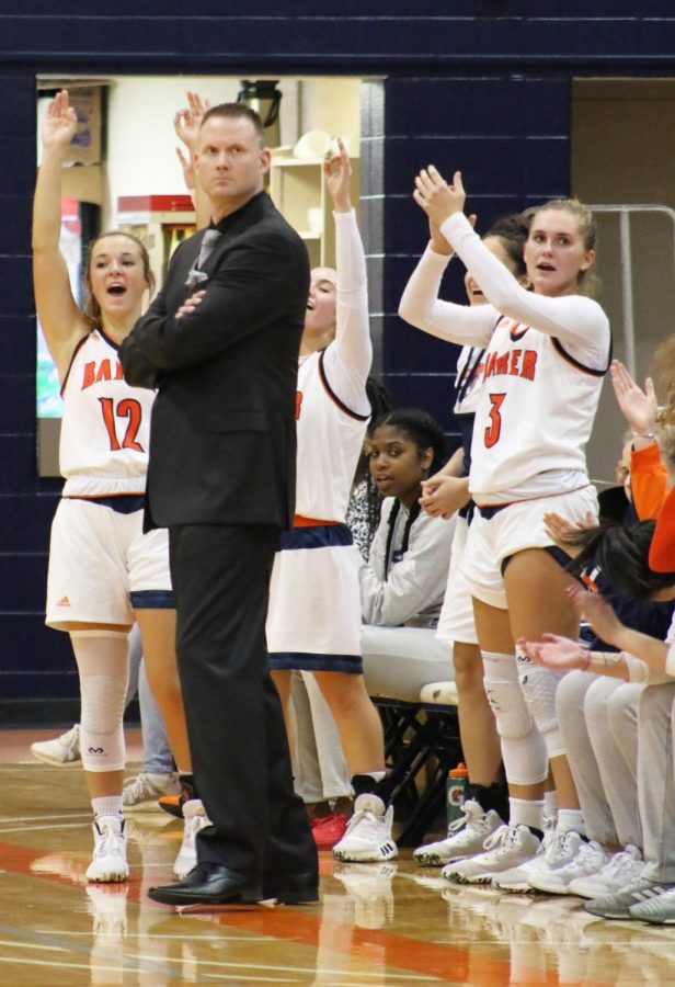 The Wildcat bench celebrates a converted three-pointer by Junior Abby Bird. Head coach Justin Rees enters his 2nd season with a 17-14 first season record.