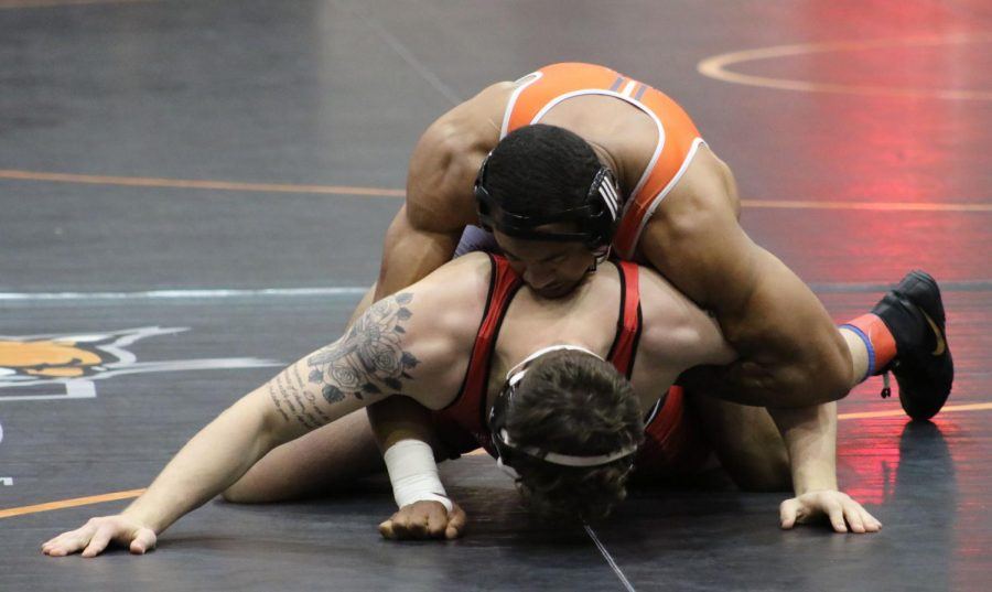 Senior David Dow faces off against Benedictine University in his first match of the Dan Harris Open. Dow defeated the Benedictine wrestler by pin to advance.