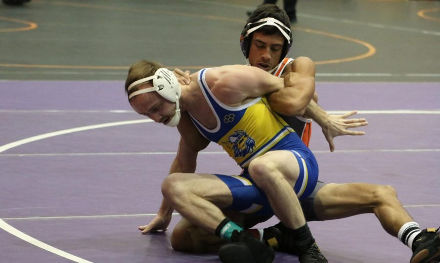 Junior Dominick Arellano controls a Bethany College wrestler in the Dan Harris Open in Collins Gymnasium. Arellano shared the first place finish for the 125-pound weight class with fellow Wildcat Emmanuel Browne.
