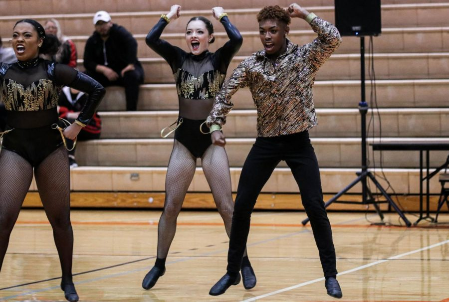 Junior Keirstyn Reynolds (left), Freshman Alyssa Waller (middle) and Sophomore Stephen Long (rIght) perform in the preliminary round. The Wildcats posted a preliminary score of 83.97.