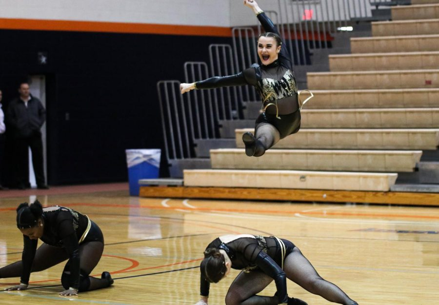 Sophomore Kinleigh Brecheisen leaps into the air during the Midwest Regional Qualifier. Coming from behind, the Wildcats took home first place with a final score of 86.016.