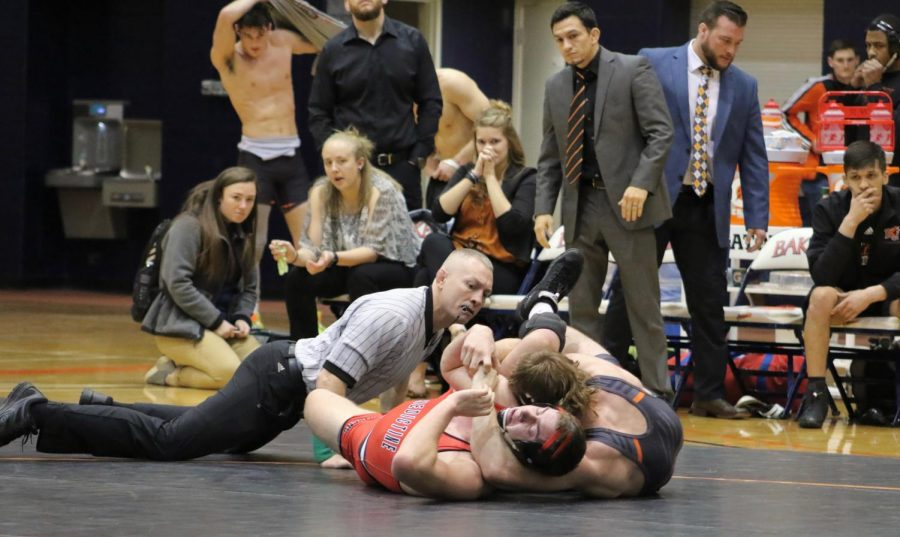 Senior Jacob Smith successfully wins the 184 pound weight class against Benedictine by tech-fall. Baker shuts out Benedictine 50-0 in home dual.