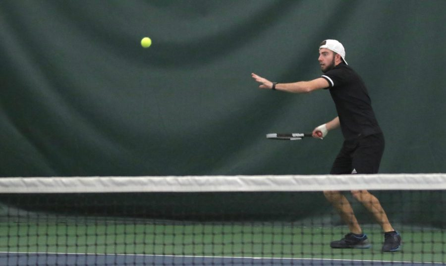 Junior Carson Fitzgerald prepares his forehand to return a hit by a Cowley County opponent. The Wildcats lose the match up with CCCC 1-6.