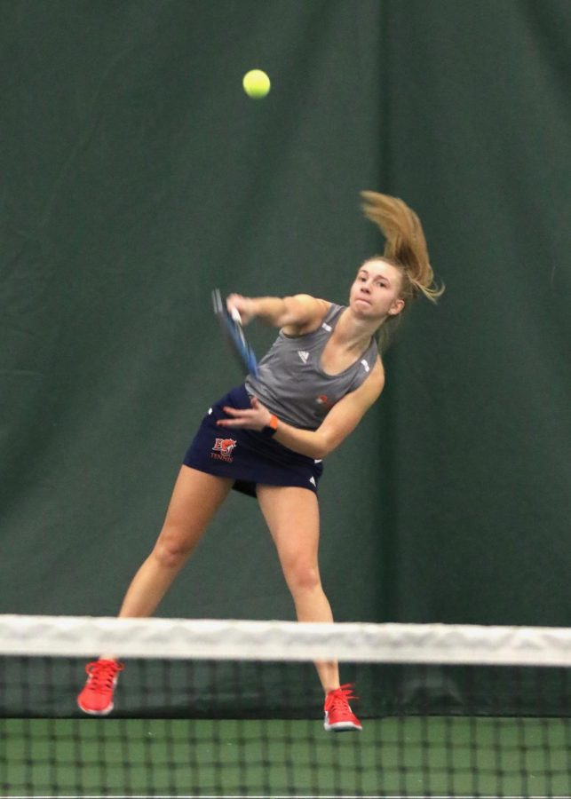 Junior Kayelee Smith serves against her opponent from Cowley County CC Feb. 1 in Lawrence. Women's tennis suffers first loss of the year 0-7 to CCCC.