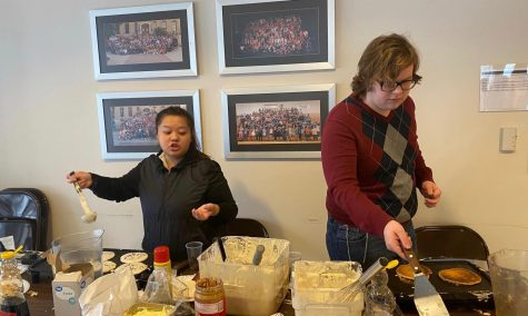 (Left) Senior Mindy Lo and sophomore Chance Prosser make pancakes for students in the Student Long Center. SAC promoted National pancake day Jan. 29 in the Long Student Center.
