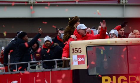Head coach of the Kansas City Chiefs Andy Reid joins the crowd in the tomahawk chop. Reid and the Chiefs celebrate their second Super Bowl title and his first as head coach.