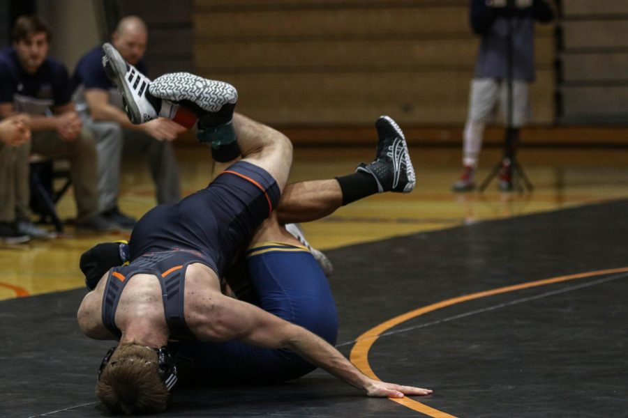 Senior Zane Baugh fights for the win against Wayland Baptist, going on to defeat his opponent by a 6-1 decision. The Wildcats defeat Wayland Baptist 40-0 conserving a shut out.