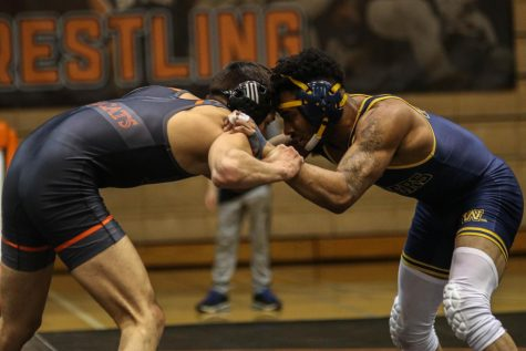 Freshman Asiel Flores locks arms with his Wayland Baptist opponent on Feb. 1 in Collins Gymnasium. Flores defeats his opponent earning Baker three points towards the total.
