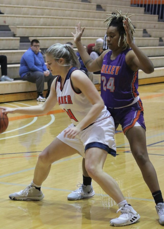 Junior Elizabeth Stark backs up towards the basket to secure a lay up. Stark finished with two points and a 25 percent field goal percentage.
