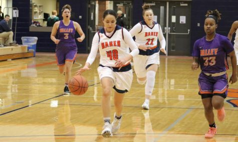 Sophomore Leslie Karolina Alvarado steals the ball for a fast break down the court to convert a two point lay up. Alvarado supported in the win against Missouri Valley College with eight points.
