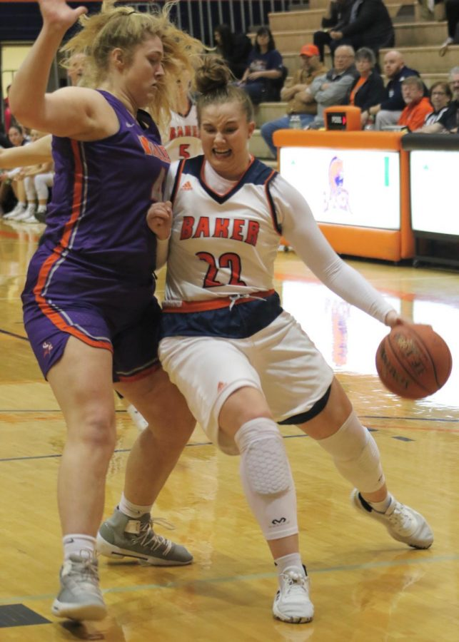 Freshman Brooke Habeck drives into the paint and is stood up by a Vikings player. Habeck led the team in scoring with 19 points in the victory.