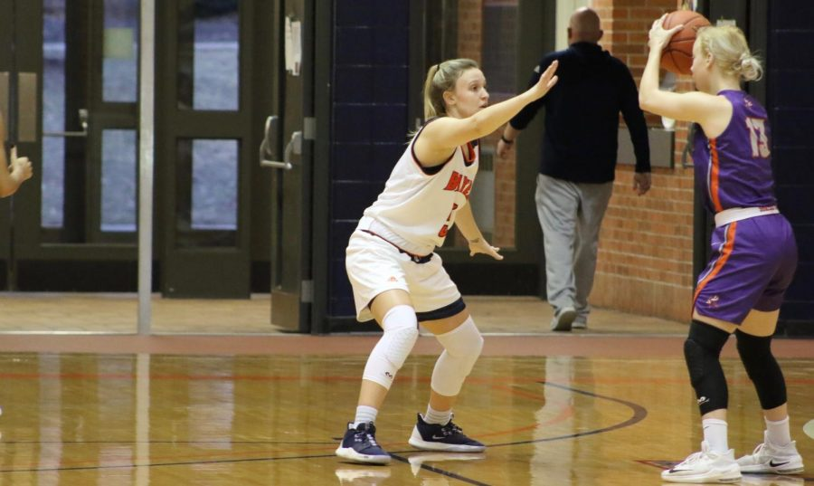 Sophomore Madison Becker pressures the Vikings point guard. Becker helps Baker win with five points and three rebounds.