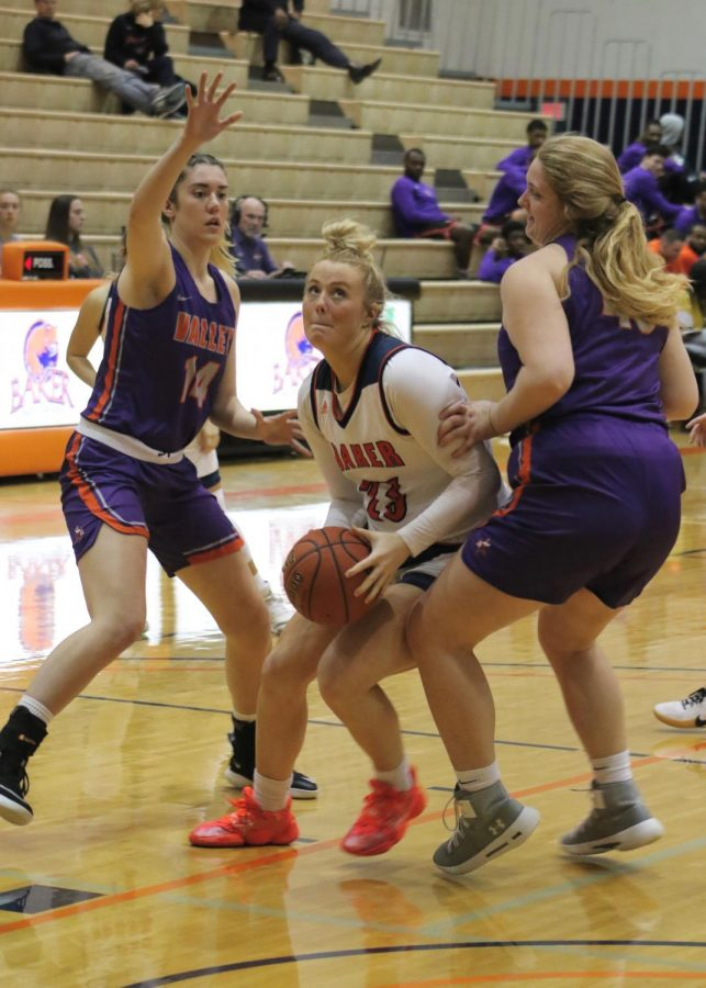 Junior Abby Bird fights through two Missouri Valley players to convert for two points and get to the foul line. Bird was 100 percent from the free throw line with five out of five.