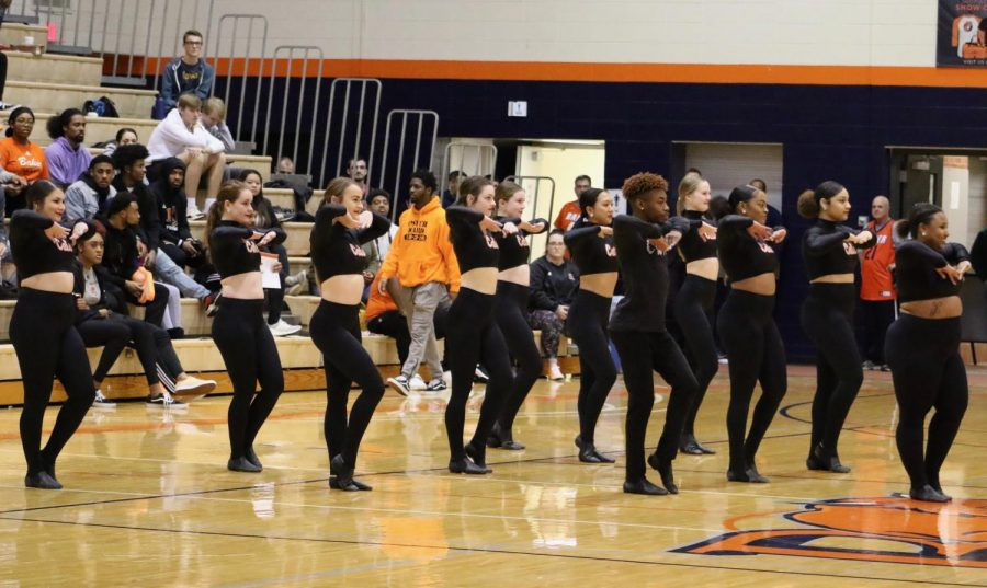 The dance team performs during halftime of the men's basketball game. Baker Dance won the Heart of America Conference Championship Feb. 15 with a score of 84.31.