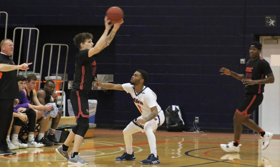Sophomore Jalen Patterson touches the Vikings player for a defensive presence. Patterson scored 21 points along with Elam and contributed to defense with two steals.
