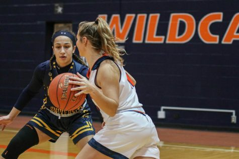 Freshman Macey Frost takes the ball down court during Saturday's game against Mount Mercy. The Wildcats won 59-55.