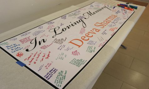 Students and faculty came together in the Long Student Center on Feb. 25 to sign a banner to honor Admissions Counselor Deeva Sharma.