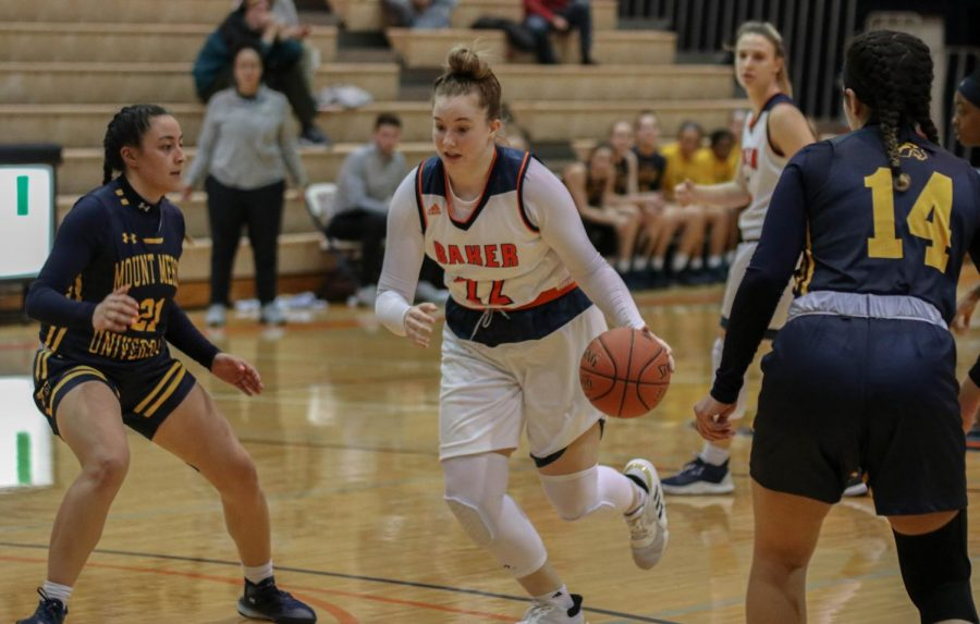Freshman Brooke Habeck, drives the ball to score.  Habeck scored eleven points on the game and was a key player in the Wildcat's win over Mount Mercy.