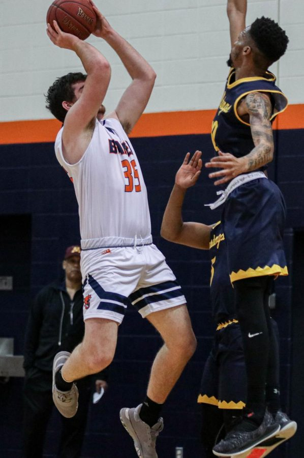 Freshman Braden Wiggs hits a jump shot during Saturdays match up against Mount Mercy. Wiggs scored 13 points and went five for seven from the field.