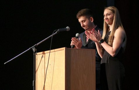 Current president of Zeta Chi, Dylan Kort and current Tri Delta President, Kayelee Smith host the annual Greek Awards Night in Rice Auditorium.