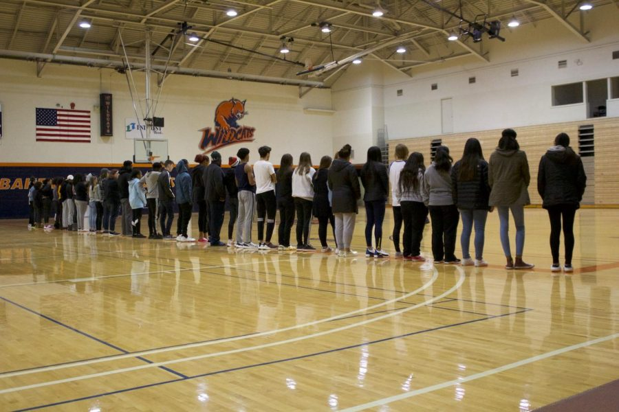 Students stand at the starting line for Mungano's Privilege Walk on Feb. 12.