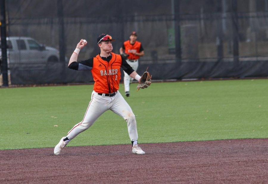 Senior Brian Wircenske fields a ball at shortstop and throws out the runner at first.