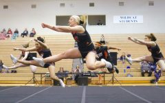 The cheer team improved it's performance for the qualifiers at the end of the season to seek an eighth place finish.