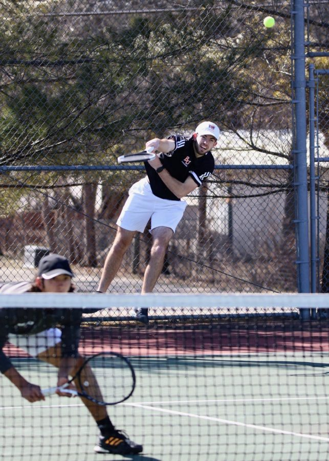 Junior Carson Fitzgerald serves in a doubles match with sophomore Alejandro Hernandez against Ottawa University. Fitzgerald and Hernandez drop the series to Claudio Quinones and Eric Czapinski of Ottawa.
