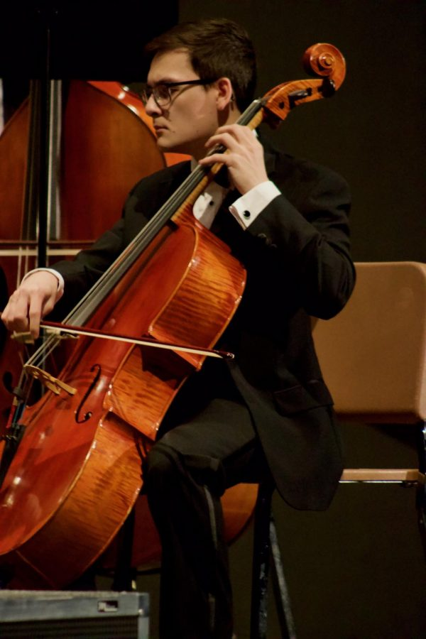 Senior Andrew Dau playing the cello during the orchestra concert held on March 10 in Rice Auditorium.