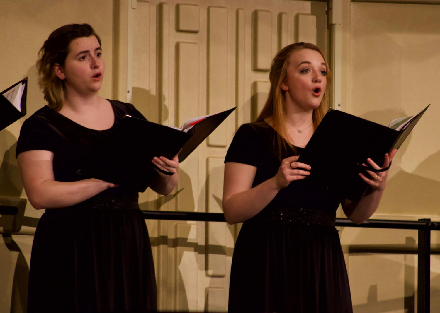 Senior Rose Ulrich and junior Celeste Kincaid singing during their performance held on March 10. Their concert was held in Rice Auditorium. The performers consists of students, faculty, and community members.