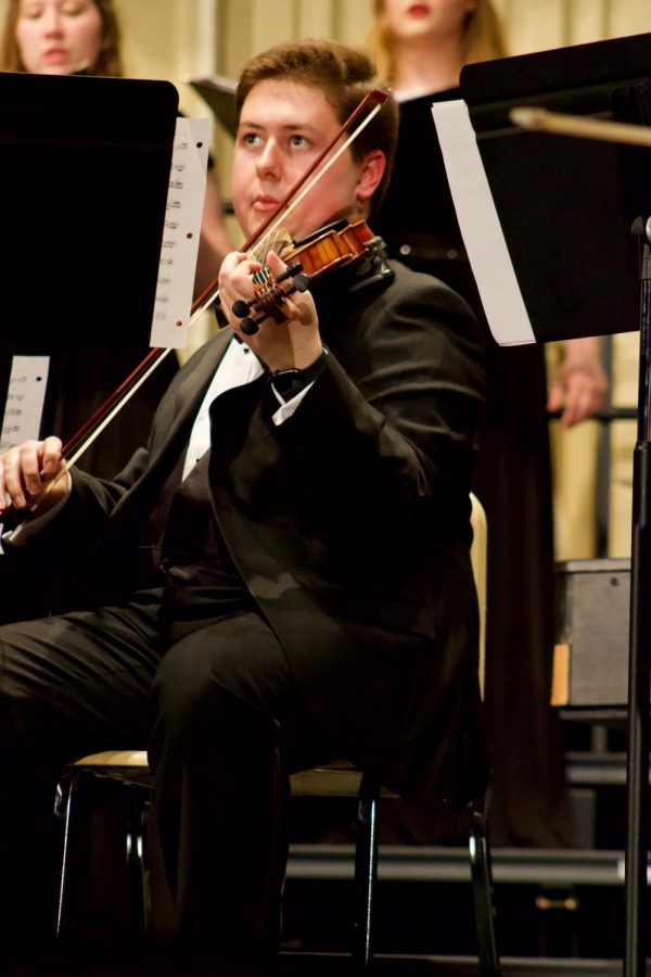 Sophomore William Clark playing the violin during their performance held in Rice Auditorium for the Baker community.