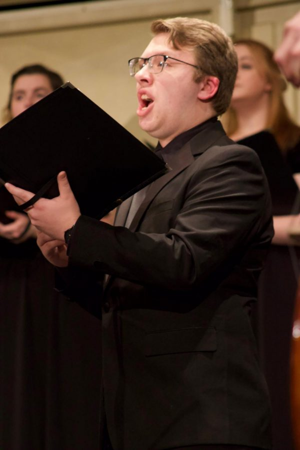 Junior Jesse Bentz singing a solo piece during the orchestra concert in Rice Auditorium. The concert was in tribute of Bach and Beethoven.
