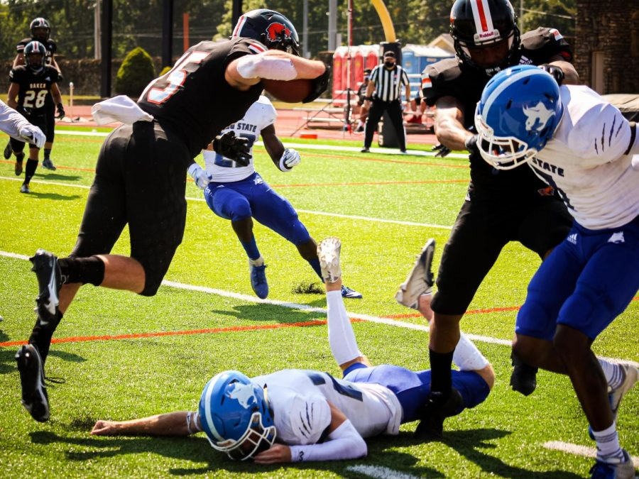 Wide receiver Sam Huckabee flies over the Peru State defense while gaining yardage for the Wildcats. Huckabee received for 73 yards and one touchdown.
