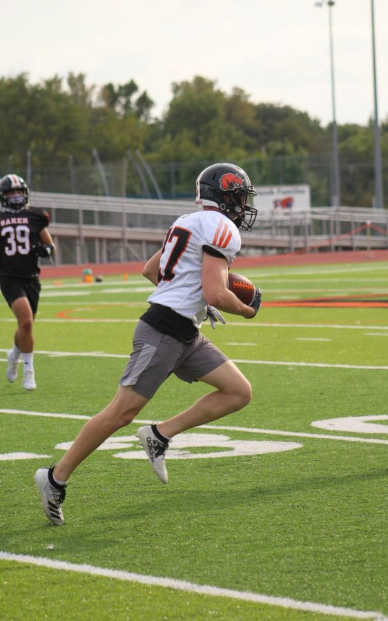 Freshman wide receiver Will Roberts catches a pass in practice.