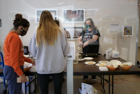 Students remained behind a plastic shield as they served their peers and faculty pancakes.