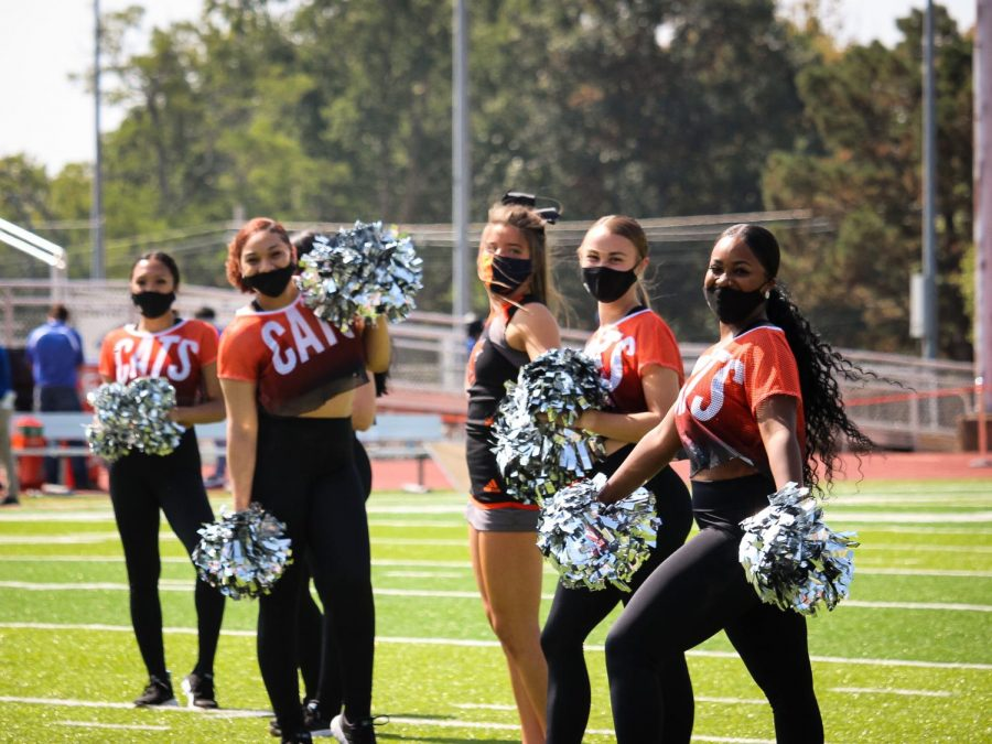 The Baker Dance Team brings spirit to the field in anticipation for the football team's arrival. The Baker Dance team earned First Place at the 2020 Midwest Regional Qualifiers in February.