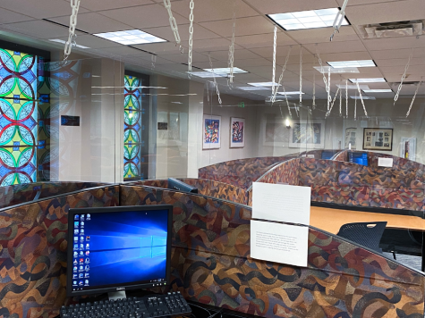 Plexiglass now hangs throughout Collins Library, a high traffic area on campus. The newly-installed plexiglass is important in maintaining safe distances while in the library.